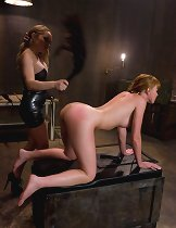 Hot redhead in sexy lesbian domination