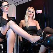 Two beautiful Mistresses and an adoring foot slave