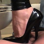 A trampled sissyboy worshipping mistress` feet