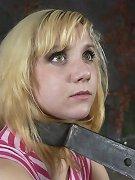 Blonde in metal bondage