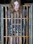 Slave locked in a cage and teased with a vibrator