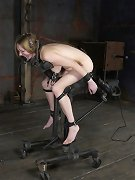 Pretty slavegirl in painful metal bondage