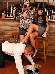 Two mistresses and their foot slave