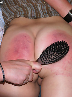 <!–-IMAGE_COUNT-–> of Girl gets spanking by hairbrush
