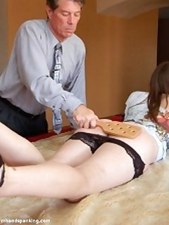 <!–-IMAGE_COUNT-–> of Belinda Lawson willingly accepts her spanking and paddling