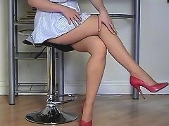 Naughty nurse talks about her heels and stockings