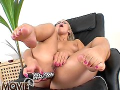 Blonde Candy touching softly her feet