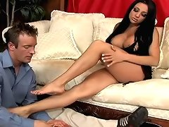 Hot busty Audrey gives guys cock an amazing foot massage
