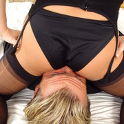 dominatrix sat on slave's face