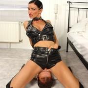 A leather domina sat on slave