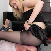 Blonde in pantyhos sat on man's face
