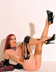 Emily Marilyn the official vintage stockings queen in a tight laced corset and leather gloves