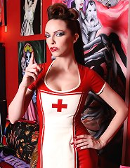 Emily Marilyn red rubber dominatrix nurse in fishnet stockings