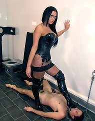 Leather mistress tramples male whore