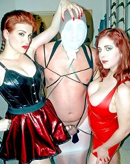 Two redhead dominatrix bathing their male slave before training session