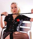Blonde in black latex