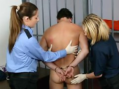 A bad prisoner getting strip searched by hotties
