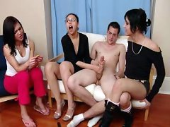 Three clothed girls toy with this guys hard rod