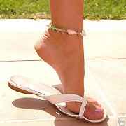 Painted bare toes in flats