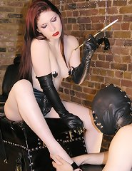 Mistress Lillith takes a smoking break and forces her slave worship her feet.
