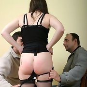 Two guys spanking otk babe