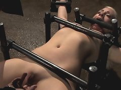 Hot blond bound in metal device and water tortured. Made to cum!