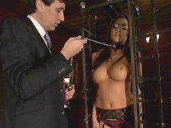 Busty Asian purchased as sex slave in fantasy bondage scene.