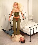 Blonde chick jumps on man.