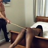 Chubby ebony girl is caned on her big round ass
