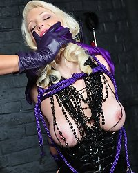 Sexy blonde is rope bound in the dungeon and then gagged and groped by her Mistress