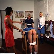 Two schoolgirls are taught how to cane each other