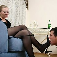 Young bear takes his domina's hose off with his teeth and gets down to licking her smelly feet