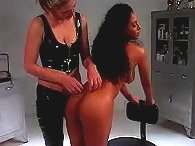 Beautiful Blonde mistress spanks an exotic Asian vixen