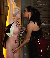 Busty blond sub is tied up, dominated, and shocked by stunning lesbian Mistress
