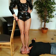 Brunette babe in pantyhose tramples slave.