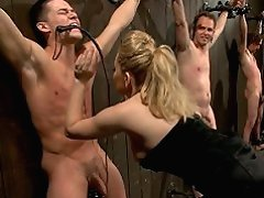2 blonde dominatrixes take three newbie slaveboys for a test drive. Humiliation, denial, CBT, CFNM, foot worship, ass worship, anal strap on included.