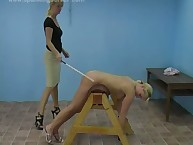 Caning act with two hot blonde babes