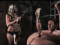 Lesbian mistress loves to cane
