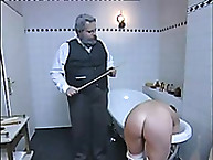 Naughty Maid Stripped Naked and Caned Over Tub
