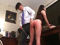 Ass caning experiment with brunette